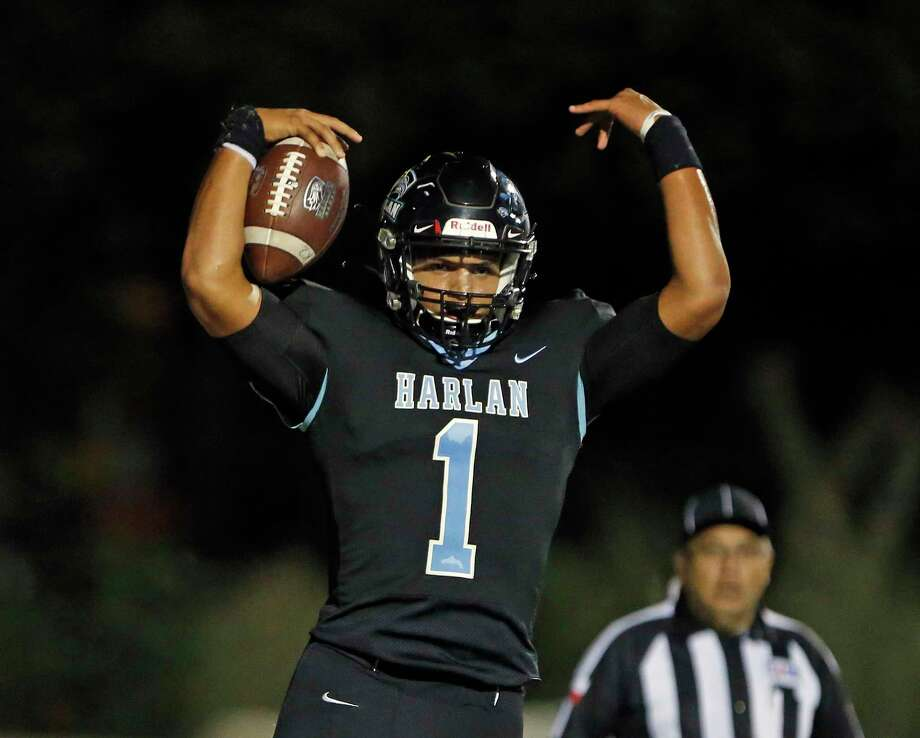 Harlan quarterback Kannon Williams celebrates his touchdown in the first half in a District 14-5A-I between Harlandale and Harlan on Friday, October 4, 2019 at Farris Stadium.