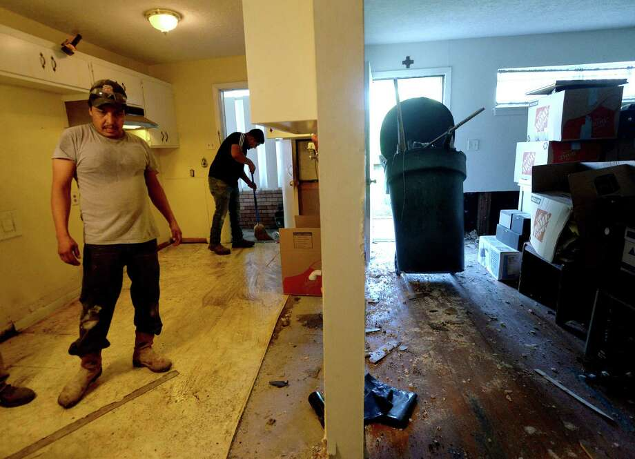 A Servpro crew from Baton Rouge guts inside Theresa Kennerson's flooded home on S. 29th Street as residents throughout flooded Beaumont neighborhoods get to the work of gutting their damaged homes Tuesday. Photo taken Tuesday, September 24, 2019 Kim Brent/The Enterprise Photo: Kim Brent / The Enterprise / BEN