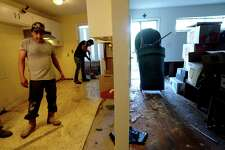 A Servpro crew from Baton Rouge guts inside Theresa Kennerson's flooded home on S. 29th Street as residents throughout flooded Beaumont neighborhoods get to the work of gutting their damaged homes Tuesday. Photo taken Tuesday, September 24, 2019 Kim Brent/The Enterprise