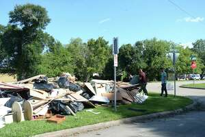 Large piles form alongside Lucas near S. 29th Street as residents throughout flooded Beaumont neighborhoods get to the work of gutting their damaged homes Tuesday. Photo taken Tuesday, September 24, 2019 Kim Brent/The Enterprise