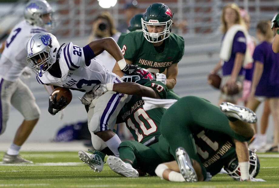 Klein Cain running back Jaydon Blue (23) is wrapped up by The Woodlands linebacker Dawson Shepherd (10) during the first quarter of a District 15-6A high school football game at Woodforest Bank Stadium, Friday, Oct. 4, 2019, in Shenandoah. Photo: Jason Fochtman/Staff Photographer