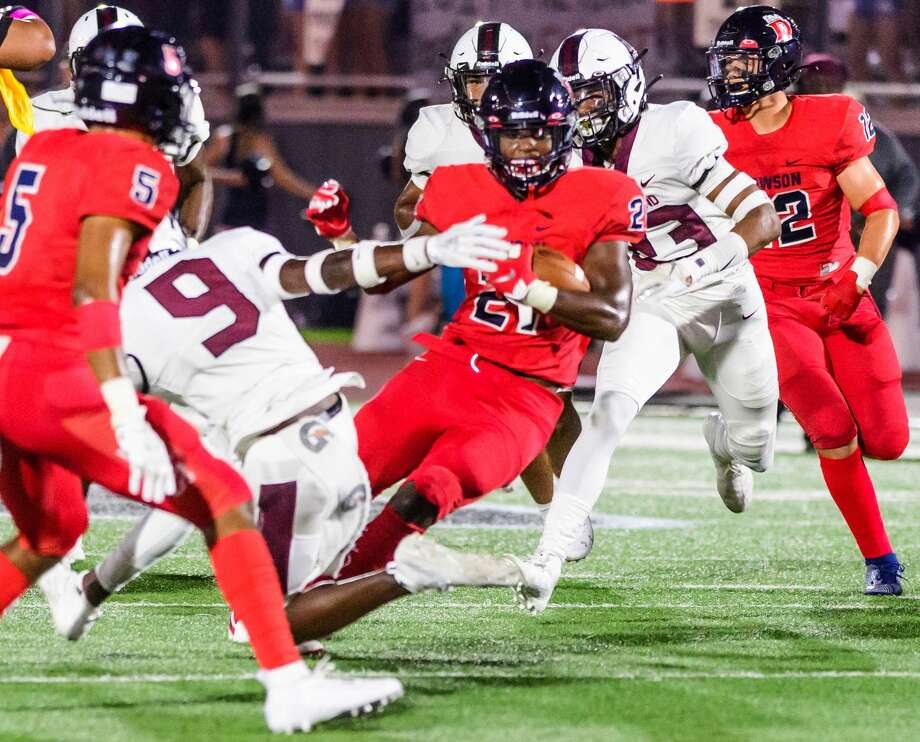 Dawson #21 Ja'Den Stewart tries to get away from Pearland #9 Brenden Stokes during the Dawson vs Pearland football game at The Rig/Pearland stadium, Pearland, TX, Oct. 4, 2019 Photo: Kim Christensen
