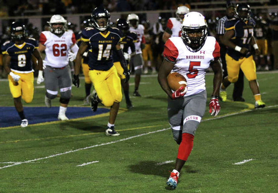 Alton running back Tim Johnson (5) heads toward the sideline on his way to a big gain in the Redbirds' SWC victory over the Panthers in O'Fallon. Johnson rushed for 155 yards in the win. Photo: Greg Shashack | The Telegraph