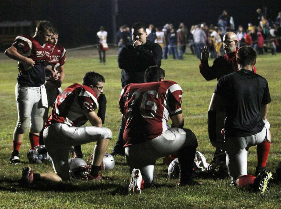 An injury late in the second quarter forced the Owen-Gage Bulldogs to forfeit another game this season, losing 12-0 to Bay City All Saints on the road Friday night. Photo: Mark Birdsall/Huron Daily Tribune, File