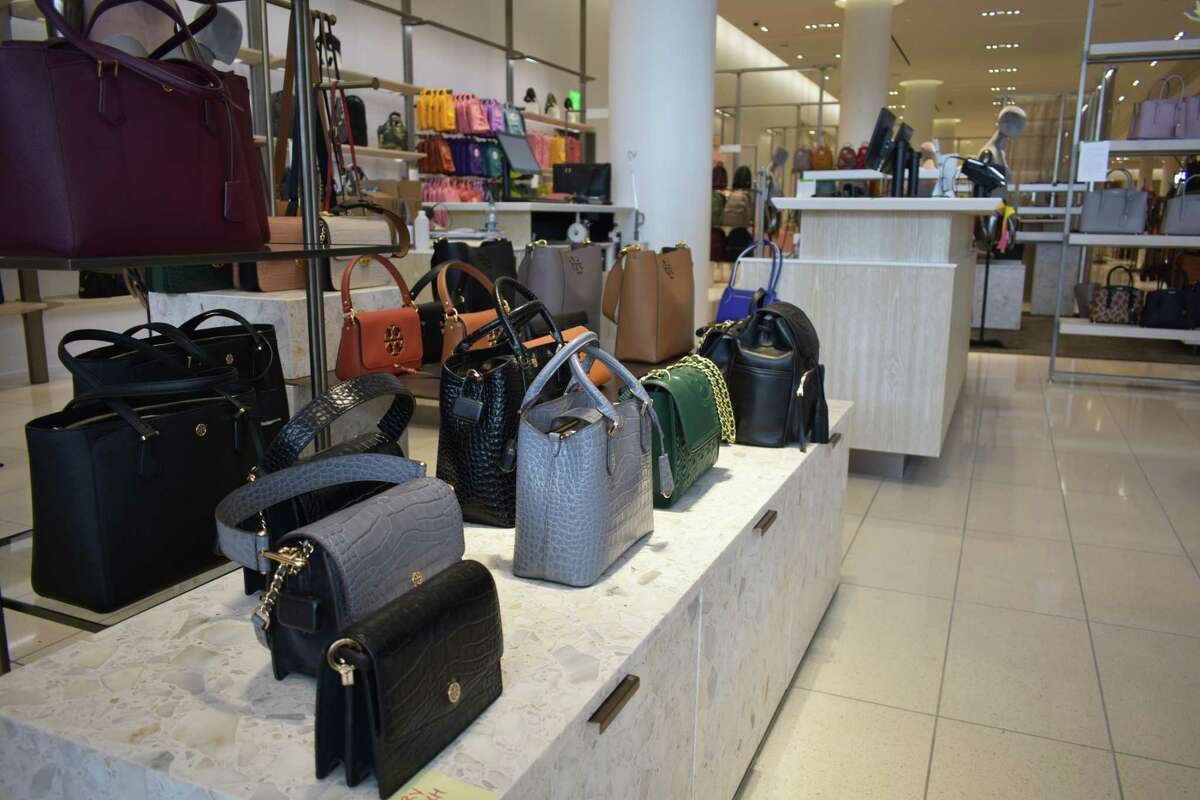 A handbag display at the Nordstrom SoNo Collection store in Norwalk, Conn., slated to open Oct. 11. Nordstrom carries bags from Norwalk-based Dooney & Bourke and apparel from Vineyard Vines, based in Stamford, among other Connecticut companies.