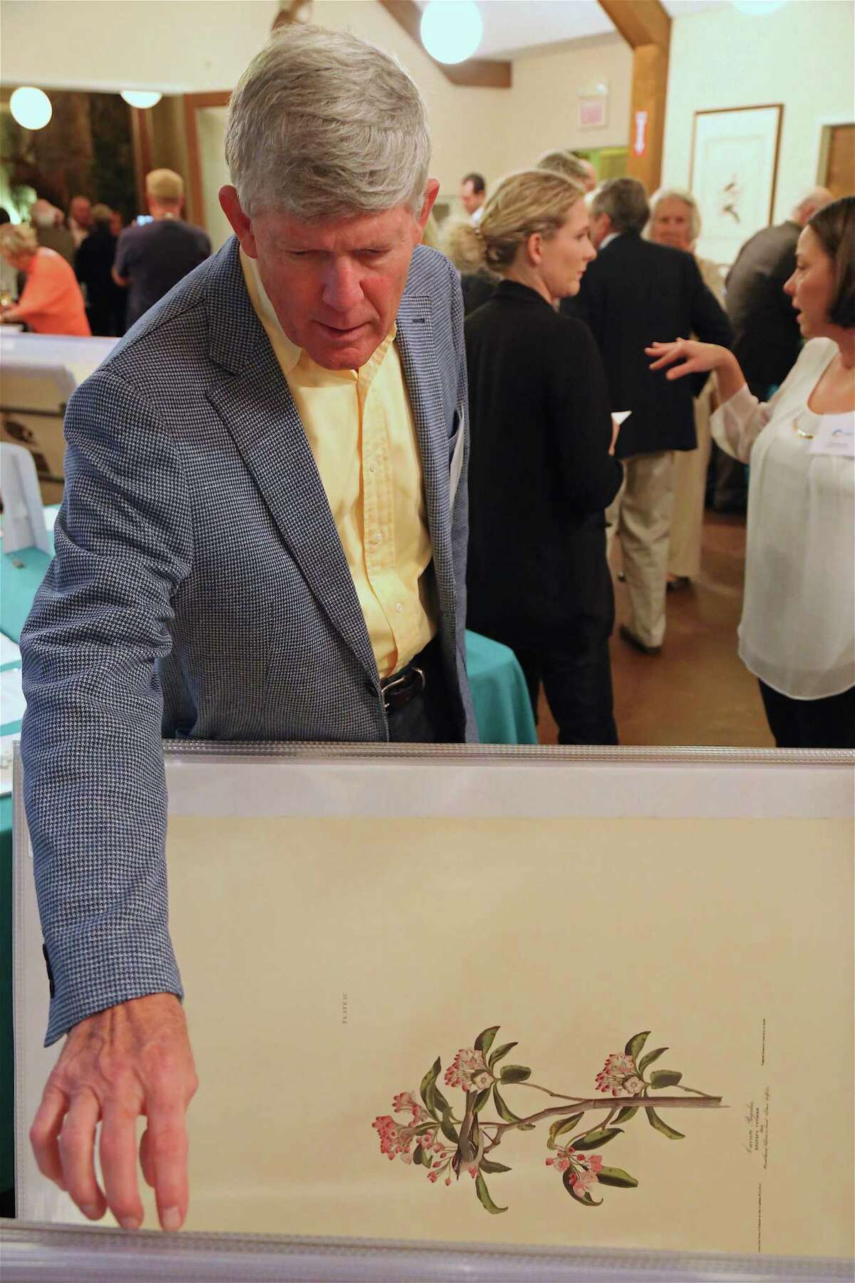 Christopher Wright of Southport explores some prints at the Fall Nature Festival's evening reception at The Connecticut Audubon Society, Friday, Oct. 4, 2019, in Fairfield, Conn.