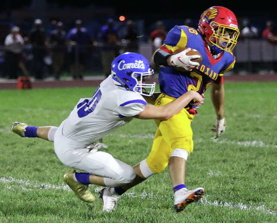 Roxana running back Michael Ilch (right) gained 100 yards and helped the shells roll past Litchfield 47-14 Friday night. He is shown in action earlier this season against Greenville. Photo: Telegraph File Photo