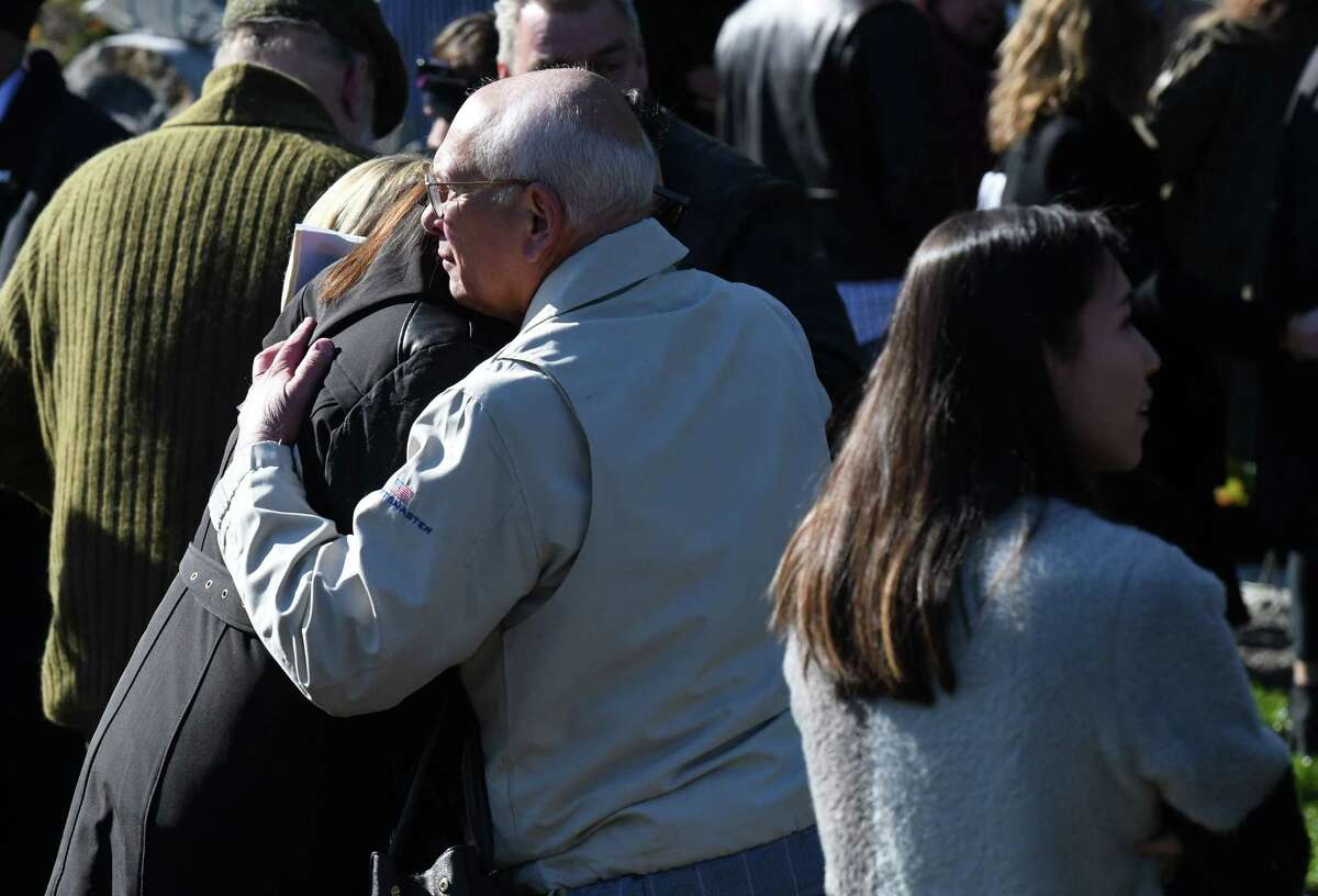 U.S. Rep. Paul Tonko embraces a mourner during an anniversary ceremony remembering victims of a deadly 2018 Schoharie limousine crash on Saturday, Oct. 5, 2019, in Schoharie, N.Y. Twenty people died in the tragic accident. (Will Waldron/Times Union)