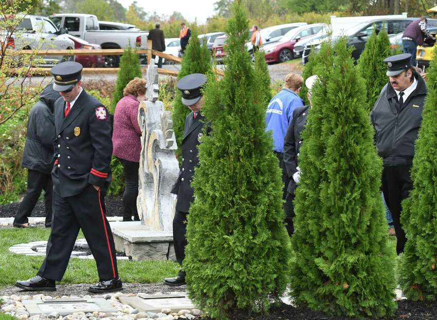 First responders attend an anniversary ceremony remembering victims of a deadly 2018 Schoharie limousine crash during an unveiling of the Reflections Memorial, a permanent memorial at the crash site, on Saturday, Oct. 5, 2019, in Schoharie, N.Y. Twenty people died in the tragic accident. (Will Waldron/Times Union)