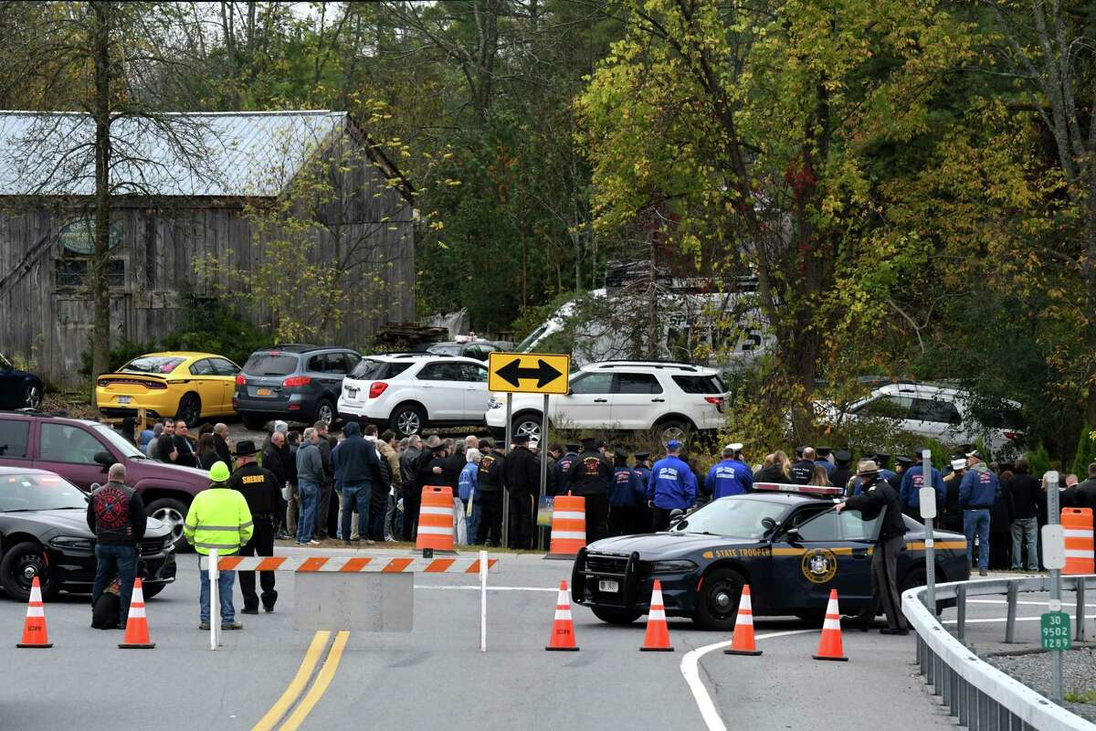 Mourners gather to remember victims of the deadly 2018 Schoharie limousine crash during an unveiling of the Reflections Memorial, a permanent memorial at the crash site, on Saturday, Oct. 5, 2019, in Schoharie, N.Y. Twenty people died in the tragic accident. (Will Waldron/Times Union)