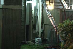 A fire ripped through a corporate apartment complex Saturday morning in southwest Houston, charring two residences and leaving 14 more with smoke and water damage.