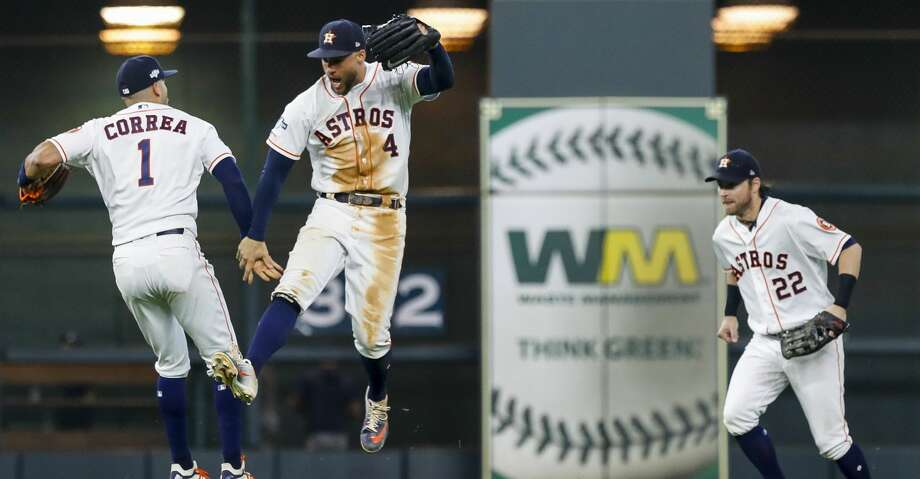 Houston Astros shortstop Carlos Correa (1) and center fielder George Springer (4) celebrate after defeating the Tampa Bay Rays 6-2 in Game 1 of the American League Division Series at Minute Maid Park on Friday, Oct. 4, 2019, in Houston. Photo: Karen Warren/Staff Photographer