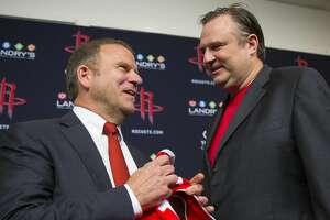 Tilman Fertitta, the new owner of the Houston Rockets, poses for pictures with Rockets general manager Daryl Morey following a press conference at Toyota Center, Tuesday, October 10, 2017. (Mark Mulligan / Houston Chronicle)