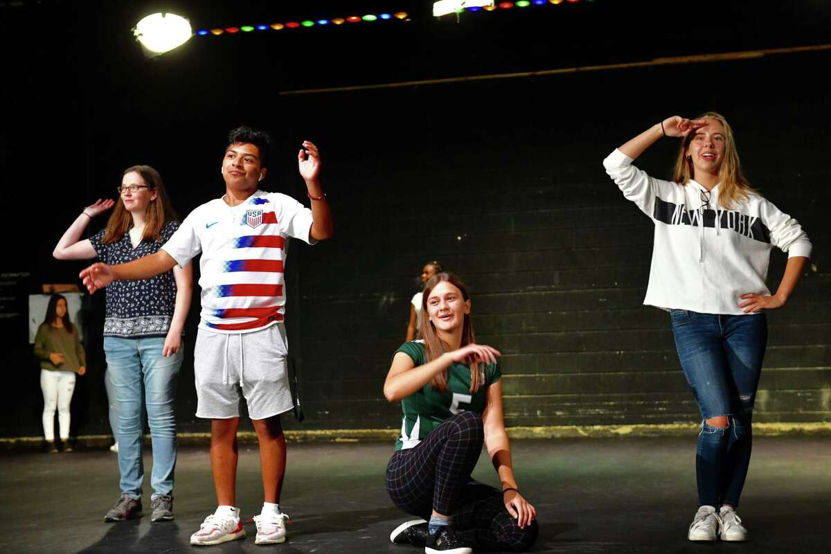 In Norwalk High School English class Dramatic Experience, Sarah Koteen, Erik Garcia, Gjesika Lleshdadaj, and Emily Araujo become part of a human machine of movement, noise and gestures.
