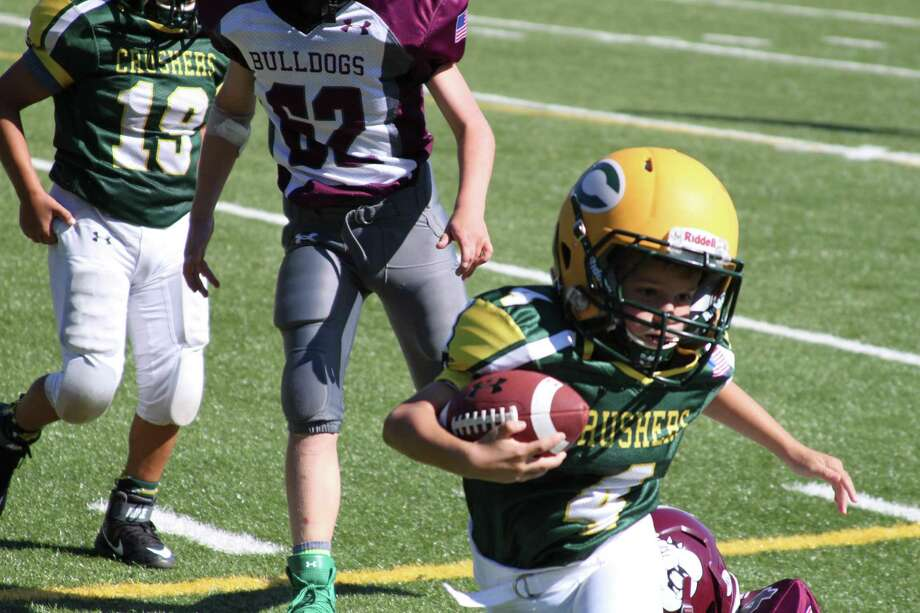 Bantam Crusher Jack Anton runs against the Bulldogs. Photo: Contributed Photo / Contributed Photo / Greenwich Time Contributed
