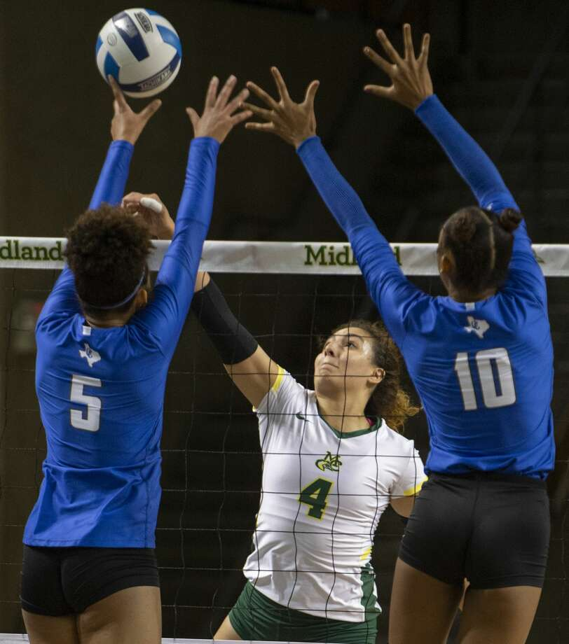 Midland College's Lina Espejo Ramirez tries to put the ball out of the reach of Odessa College's Carol Santana and Lyric Love 10/05/19 at the Midland College Chaparral Center. Tim Fischer/Reporter-Telegram Photo: Tim Fischer/Midland Reporter-Telegram