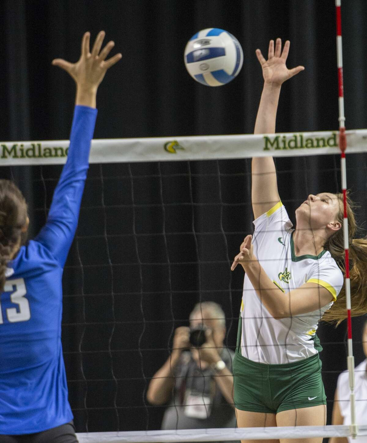 Midland College's Chesney Friesenhahn goes up for a hit as Odessa College's Maria Rodrigues tries to block 10/05/19 at the Midland College Chaparral Center. Tim Fischer/Reporter-Telegram