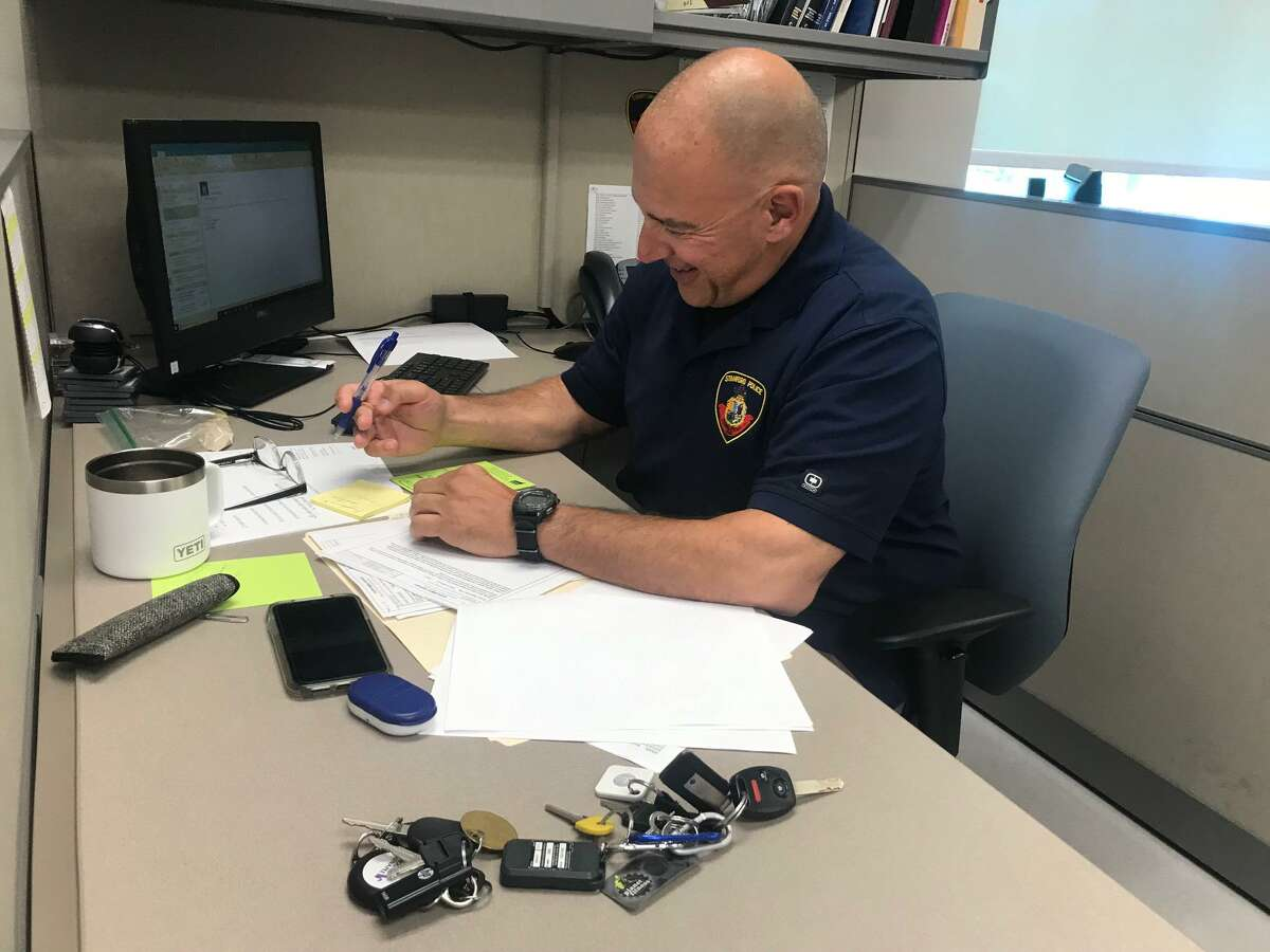 Major crimes investigator Frank Laccona at his desk at police headquarters last week. Laccona is in the squad that obtained the arrest of Michael James for the brutal murder of Torrick Johnson at the Southwood Village Apartments last week.