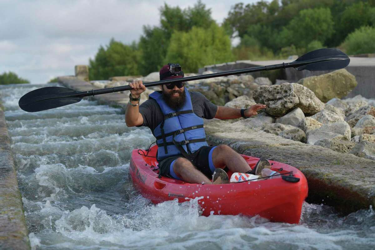 Mino Griego works his kayak at the San Antonio River Walk Mission Reach Paddling Trail on Saturday, Oct. 5, 2019.