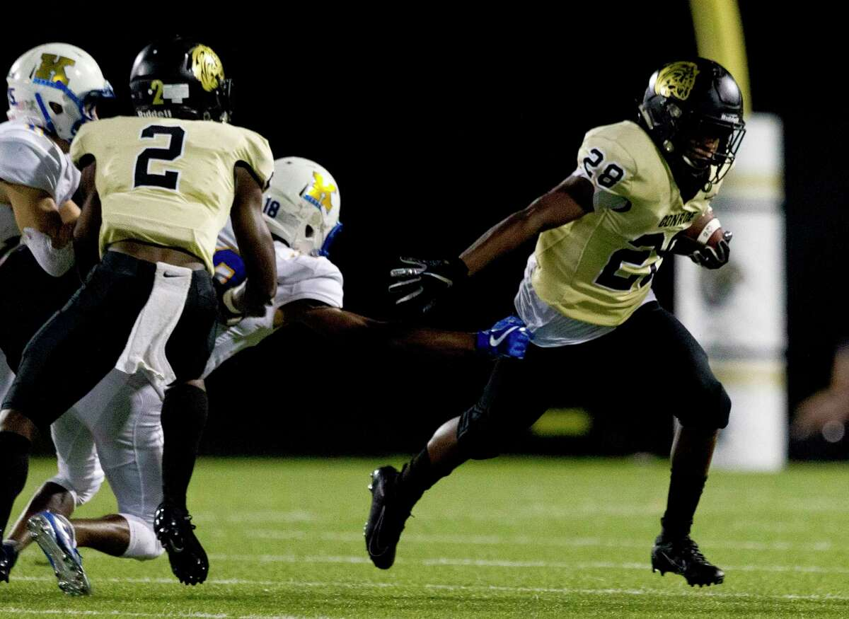 Conroe running back Jahmal Jones (28) breaks a tackle during the fourth quarter of a District 15-6A high school football game at Buddy Moorhead Stadium, Friday, Oct. 4, 2019, in Conroe.