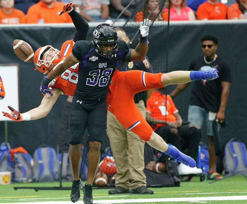Sam Houston State Bearkats tight end Woody Brandom (85) can't get a hold of the ball over Stephen F. Austin Lumberjacks safety Trenton Gordon (38) during the first half of Battle of the Piney Woods at NRG Stadium on Saturday, Oct. 5, 2019.