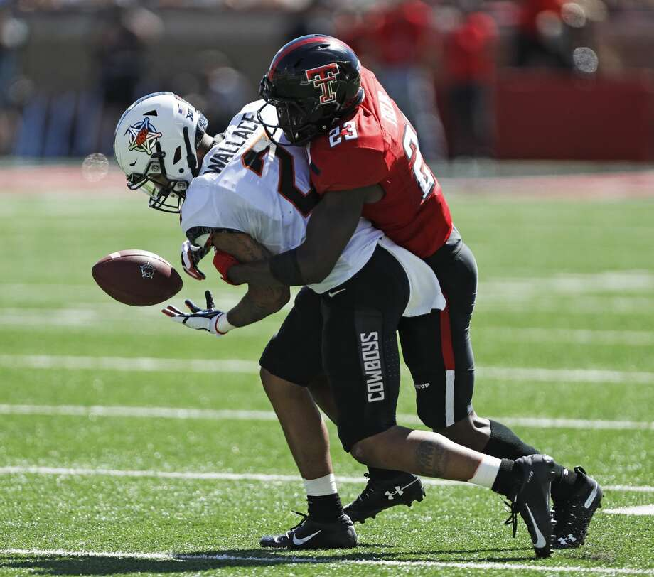 Texas Tech's Damarcus Fields (23) tackles Oklahoma State's Tylan Wallace (2) to break up a pass during the second half of an NCAA college football game Saturday, Oct. 5, 2019, in Lubbock. (AP Photo/Brad Tollefson) Photo: Brad Tollefson,  Associated Press / Copyright 2019 The Associated Press. All rights reserved.