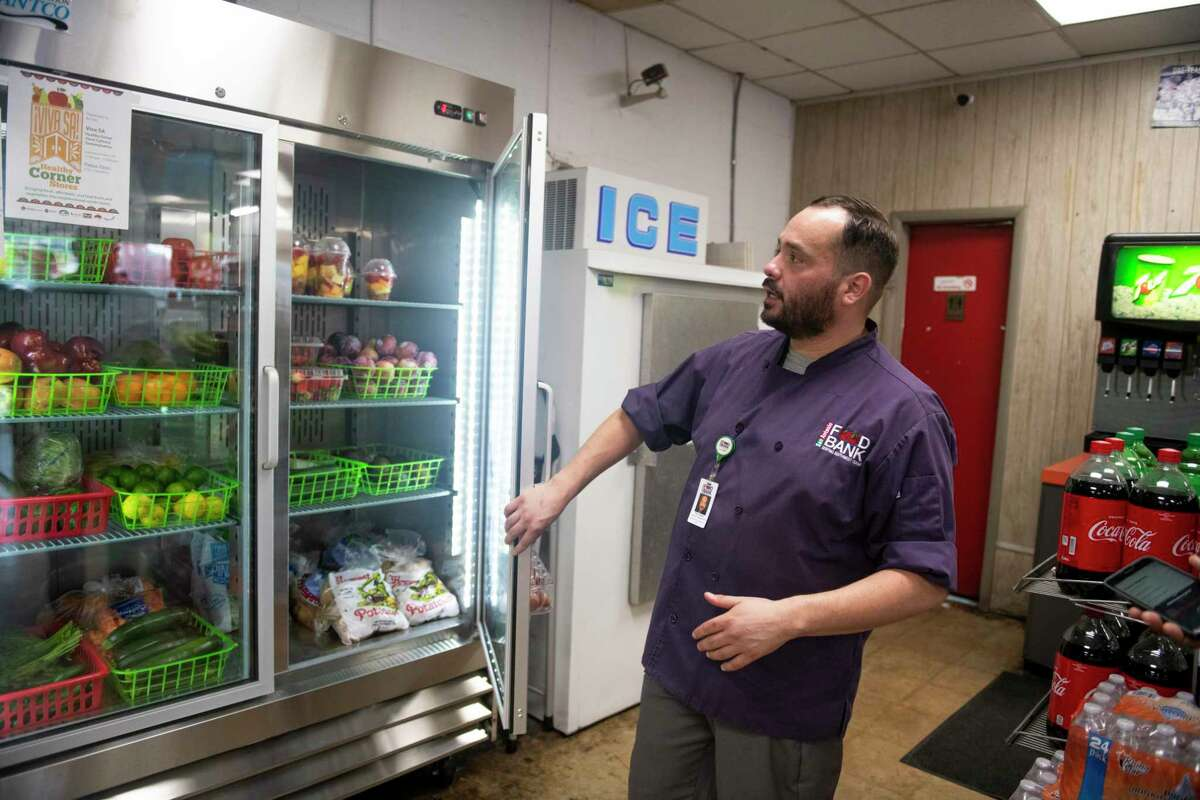 San Antonio Food Bank Nutrition Education Chef, Raul Longoria, looks at the different variety of fresh produced available at Pappa Zipps in San Antonio on Saturday, Oct. 5th, 2019. Officials said the amount of fresh produce in the South Side quadrant, considered a food desert, increased by 600 percent through a Healthy Corner Store initiative.