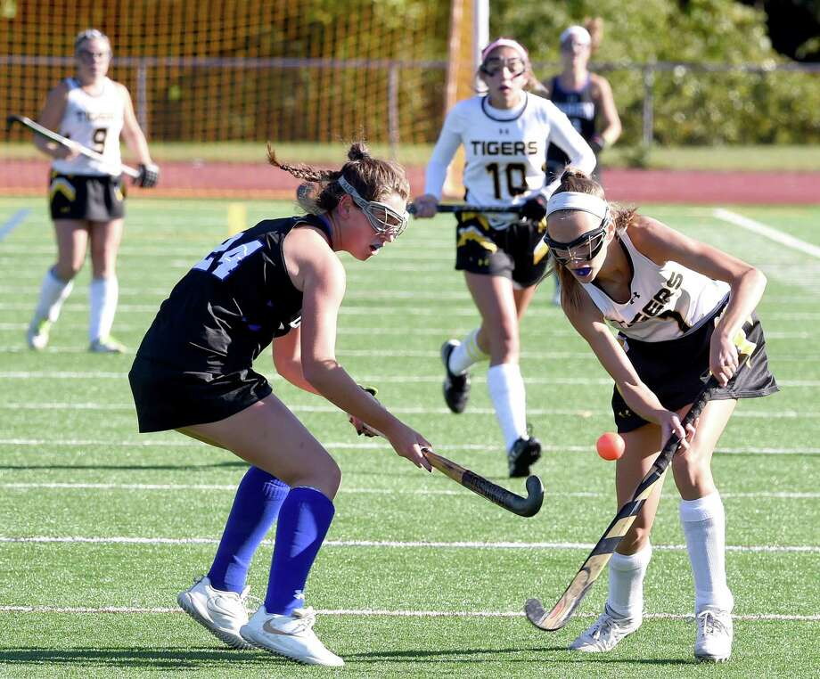 Darien's Lindsey Olson, left, and Hand's Natalie Nolan fight for the ball in the first half on Saturday. Photo: Arnold Gold / Hearst Connecticut Media / New Haven Register