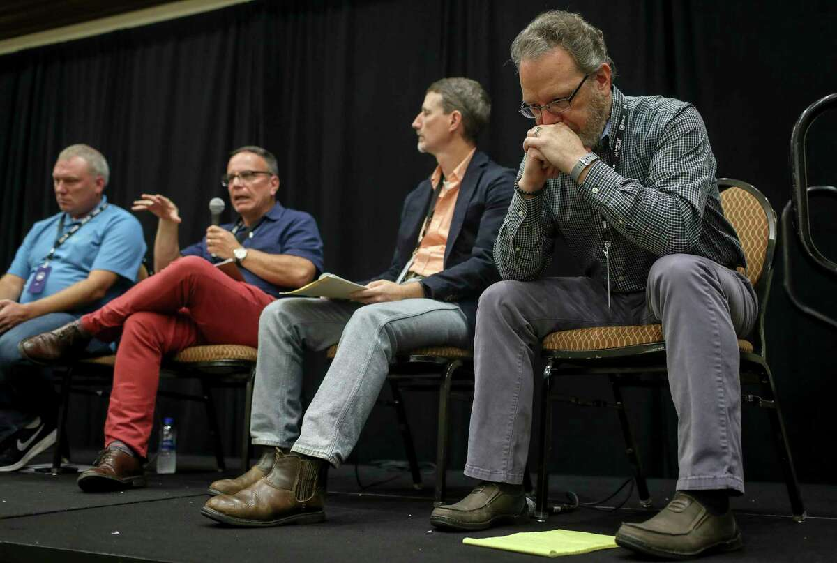 Andrew Scmutzer, right, listens to a mens-only discussion about child sexual abuse, during the Caring Well Conference, on Friday, Oct. 4, 2019, in Grapevine.