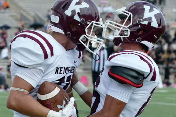 Ethan Griswell (11) and Parker Milligan (16) of Kempner celebrate a touchdown during the third quarter of a 6A Region III District 20 football game between the Bush Broncos and Kempner Cougars on Saturday, October 5, 2019 at Mercer Stadium, Sugar Land, TX.