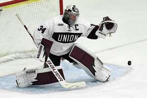 Union goaltender Darion Hanson (34) makes a save against Boston University during the first period of an NCAA college Hockey home opener game Saturday, Oct. 5, 2019, in Schenectady, N.Y.