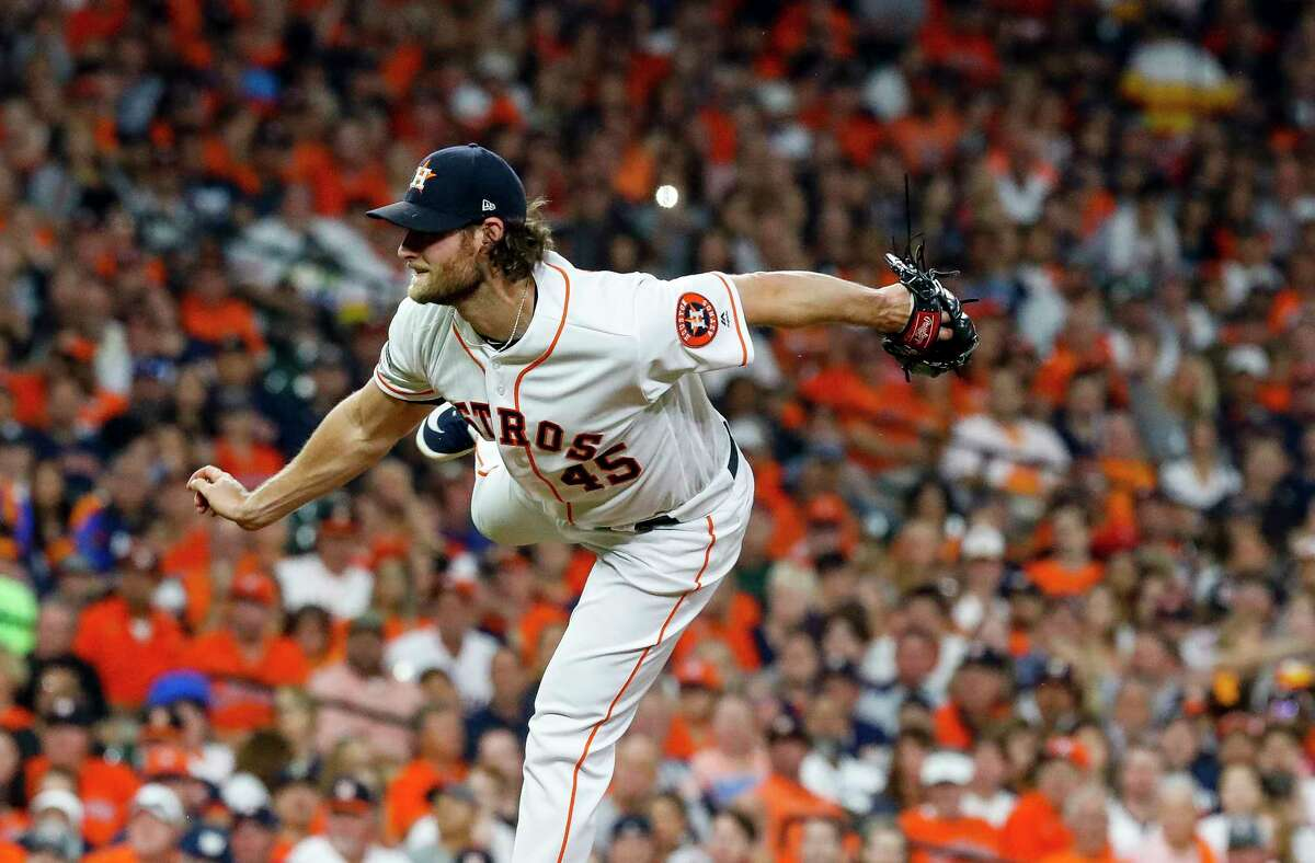 Houston Astros starting pitcher Gerrit Cole (45) pitches during the first inning of Game 2 of the American League Division Series at Minute Maid Park on Saturday, Oct. 5, 2019, in Houston.