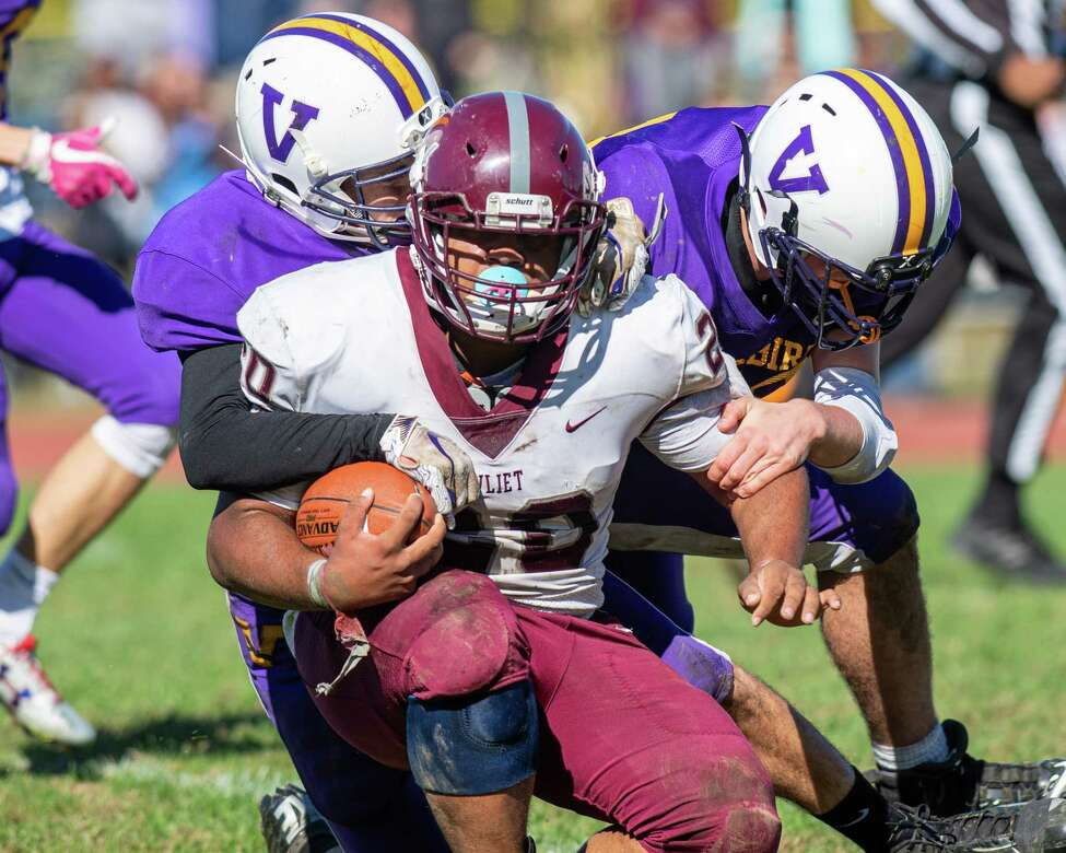Photos from Week 5: Watervliet running back Kareem Duncan is dragged down by two Voorheesville defenders during a game at Voorheesville High School on Saturday, Oct. 5, 2019 (Jim Franco/Special to the Times Union.)