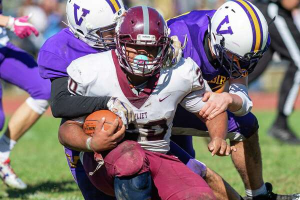Watervliet running back Kareem Duncan is dragged down by two Voorheesville defenders during a game at Voorheesville High School on Saturday, Oct. 5, 2019 (Jim Franco/Special to the Times Union.)