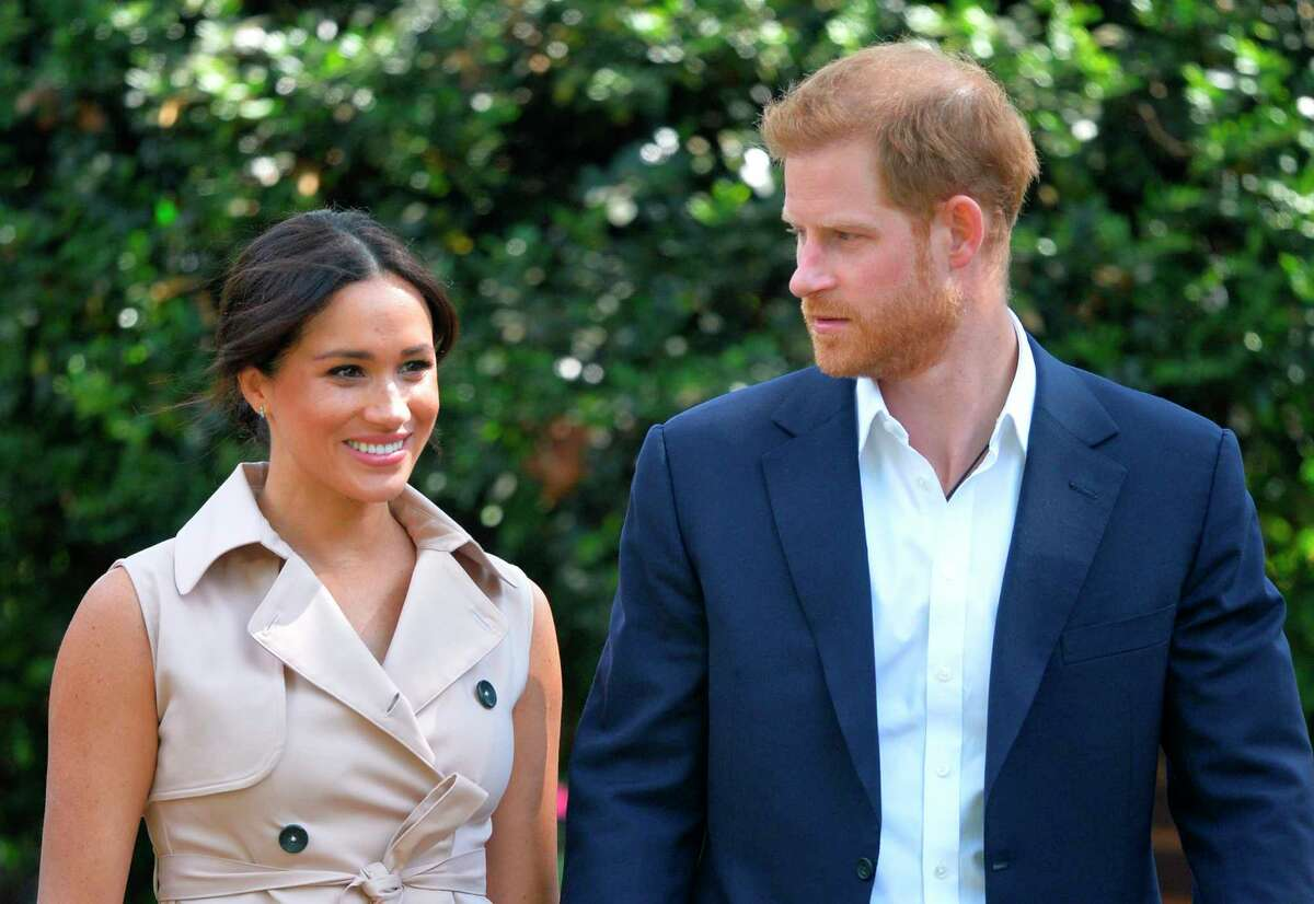 FILE - In this Wednesday Oct. 2, 2019 file photo, Britain's Harry and Meghan, Duchess of Sussex arrive at the Creative Industries and Business Reception at the British High Commissioner's residence, in Johannesburg, where they will meet with representatives of the British and South African business communities, including local youth entrepreneurs. (Dominic Lipinski/Pool via AP, File)