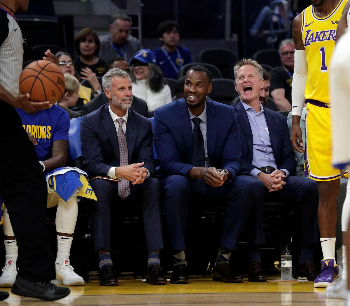 Warriors head coach Steve Kerr laughs with the referee in the second half as the Golden State Warriors played the Los Angeles Lakers in a pre-season game at Chase Center in San Francisco, Calif., on Saturday, October 5, 2019.
