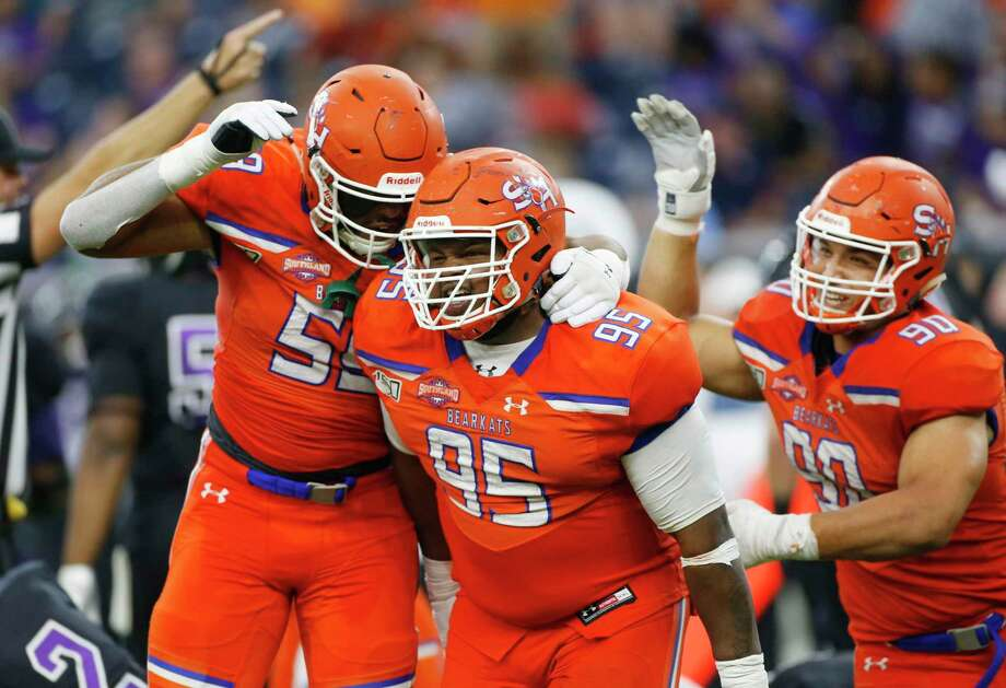 Sam Houston State Bearkats defensive lineman Joseph Wallace (95) is congratulated by his teammates after his quarterback sack caused a fumble in the fourth quarter of Battle of the Piney Woods at NRG Stadium against Stephen F. Austin on Saturday, Oct. 5, 2019. Sam Houston State won the game 31-20. Photo: Elizabeth Conley, Houston Chronicle / Staff Photographer / © 2018 Houston Chronicle