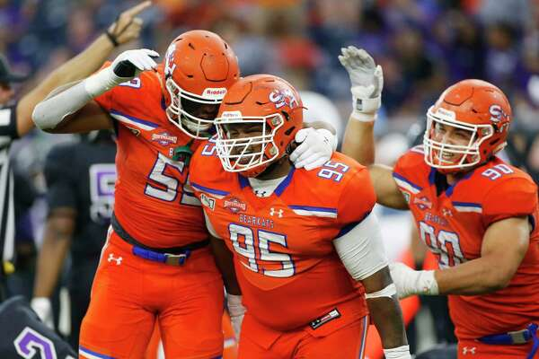 Sam Houston State Bearkats defensive lineman Joseph Wallace (95) is congratulated by his teammates after his quarterback sack caused a fumble in the fourth quarter of Battle of the Piney Woods at NRG Stadium against Stephen F. Austin on Saturday, Oct. 5, 2019. Sam Houston State won the game 31-20.