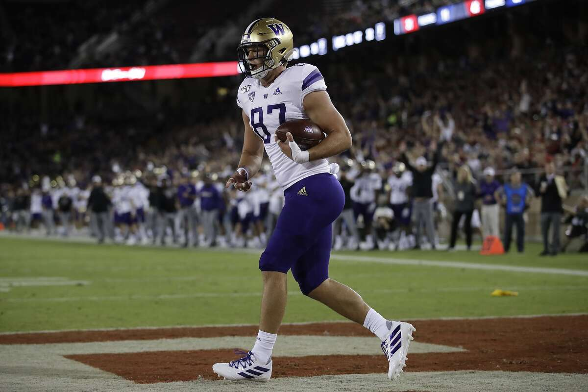 Washington's Cade Otton celebrates after scoring a touchdown against Stanford during the first half of an NCAA college football game Saturday, Oct. 5, 2019, in Stanford, Calif. (AP Photo/Ben Margot)