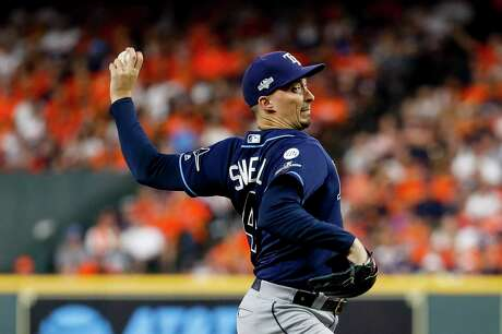 Tampa Bay Rays starting pitcher Blake Snell (4) pitches during the first inning of Game 2 of the American League Division Series at Minute Maid Park on Saturday, Oct. 5, 2019, in Houston.