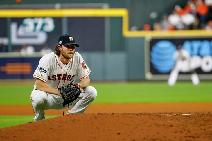 Houston Astros starting pitcher Gerrit Cole (45) squats behind the mound as he waits to pitch in the fourth inning of Game 2 of the American League Division Series at Minute Maid Park on Saturday, Oct. 5, 2019, in Houston.