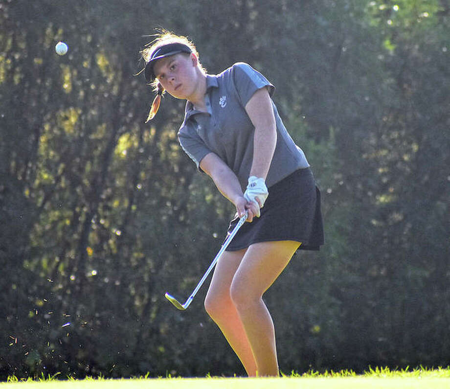 In this file photo, EHS sophomore Riley Lewis chips a shot onto the green during the second round of the Southwestern Conference Tournament at Far Oaks Golf Course. Photo: Matt Kamp|The Intelligencer