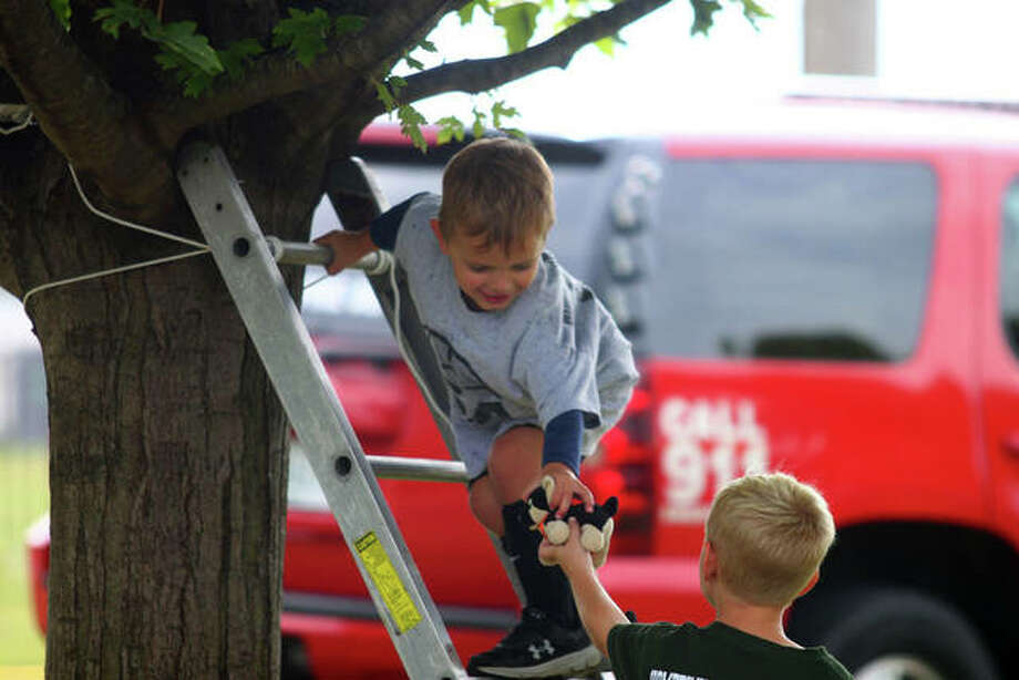 Collin Herter, 4, of Concord rescues an animal from a tree at the Jacksonville Fire Department open house Saturday. Photo: Rosalind Essig | Journal-Courier