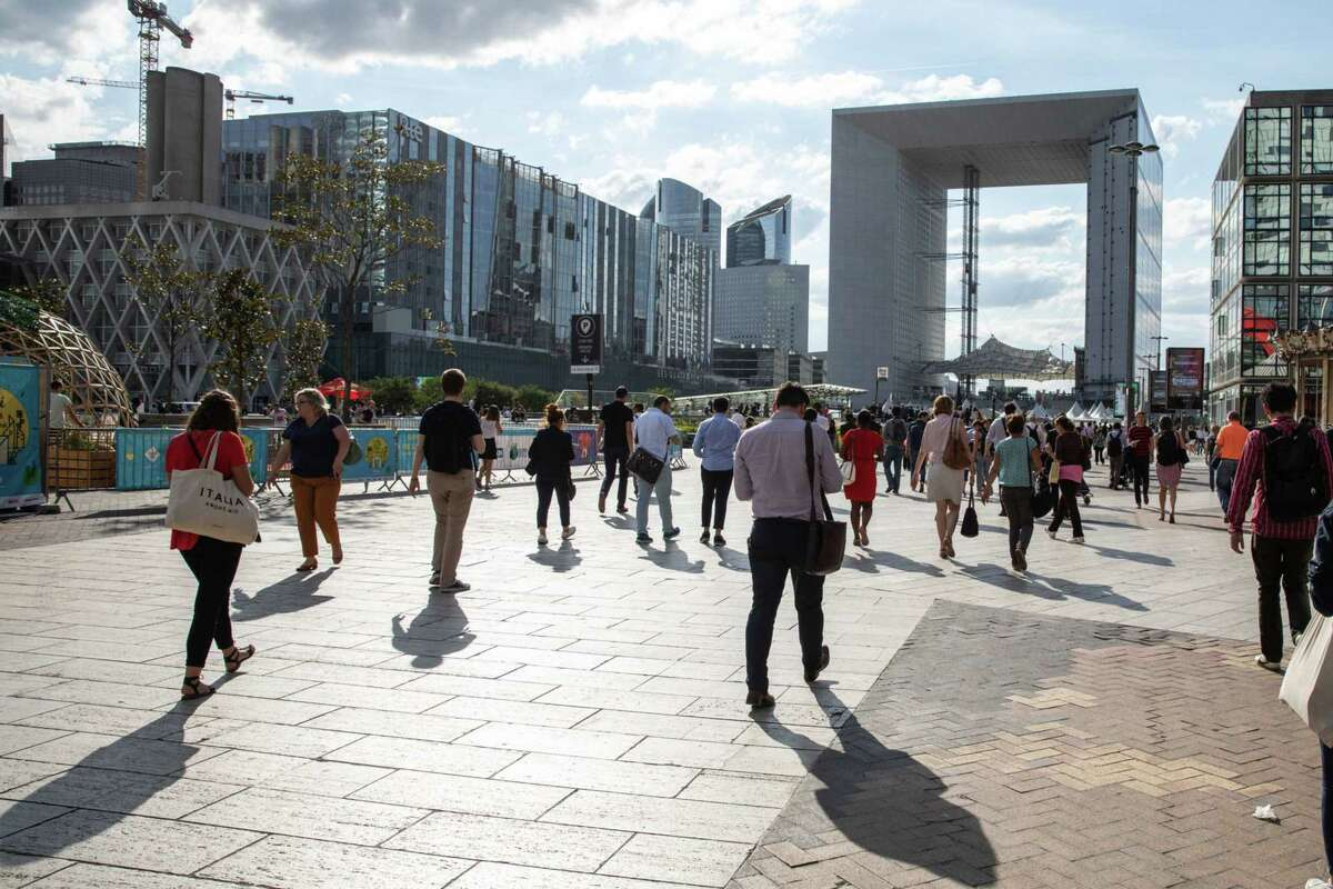 Commuters depart La Defense business district during evening rush hour in Paris on July 17, 2018.
