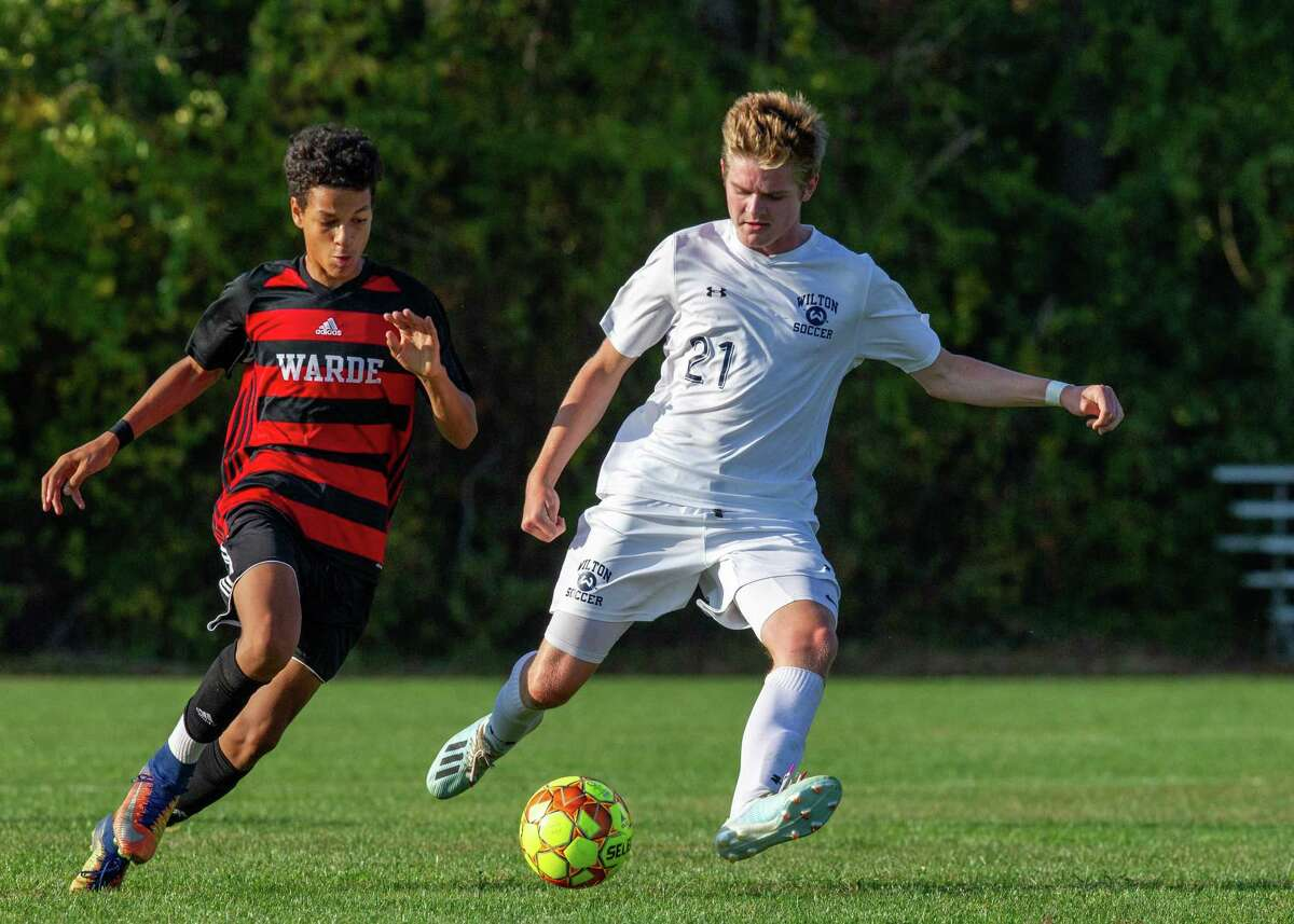 Parker Ward (right) and the Wilton boys soccer team are 6-0-2 following Saturday's 3-0 win over Danbury.