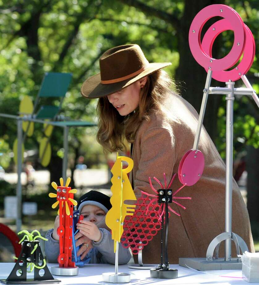 Oliver Moore, 2, of Stamford and his mother Paisley check out some of Weston, Conn. Artist Drew Klotz Kinetic Sculptures during the 38th Annual Outdoor Arts Festival at the Bruce Museum in Greenwich, Conn. on Oct. 5, 2019. The festival featured over 80 artists from 16 states and 2 foreign countries outside of the United States. Photo: Matthew Brown / Hearst Connecticut Media / Stamford Advocate