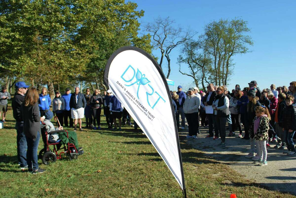 Andrea and Phil Marella of Greenwich, at left, the founders of the Dana's Angels Research Trust, start the second annual DART to the Finish charity walk with their son Andrew on Saturday at Greenwich Point Park. The charity walk funds research into Niemann Pick disease type C.