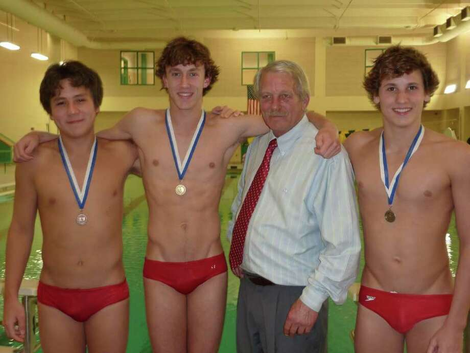 From left, Greenwich High School divers Tyler Oe, Mark O'Connell and Connor Brisson pose with their late coach Jon Hahnfeldt after the Class LL Diving Championships in March. Hahnfeldt, a high school and collegiate All-American diver, served as the Greenwich High School boys diving coach for eight seasons. The beloved coach died of a brain aneurysm on April 18. Photo: Contributed Photo / Greenwich Time Contributed