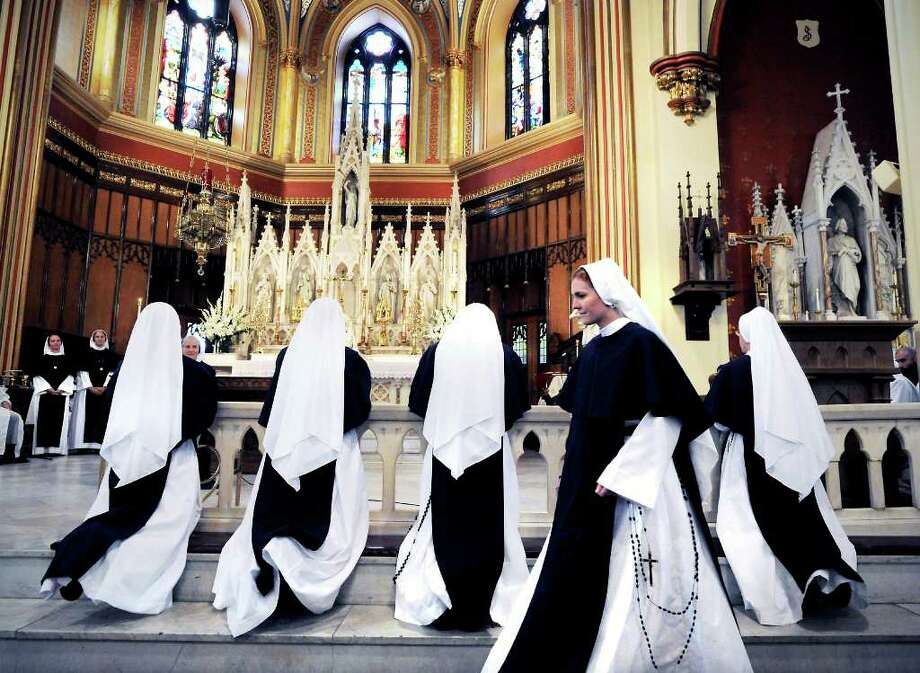 A group of women prepare to take their first profession of vows with The Sisters of Life at The Basilica of St. John the Evangelist in Stamford, Conn. on Friday August 6, 2010. Photo: Kathleen O'Rourke / Stamford Advocate