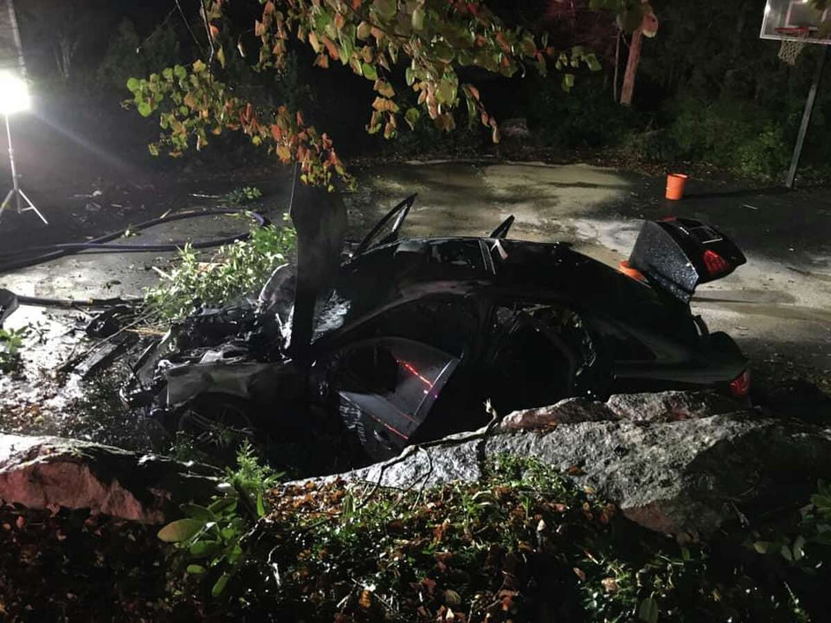 Stepney fire crews responded to an accident in Monroe Saturday night that left a black sedan almost fully engulfed in flame after the car struck a house and fell six feet onto the driveway. Several of the four occupants were injured, but none were killed, officials said.